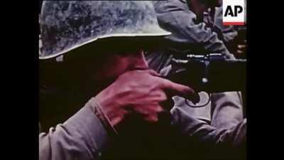 A U.S. Marine fires his M1903 Springfield rifle at Japanese forces during the Battle of Okinawa, c. 1945