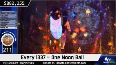 Gavin Free getting hit with a moonball during Extra Life 2019.