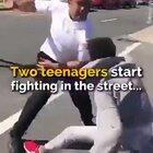 This man brilliantly breaks up a street fight between two teenage boys.