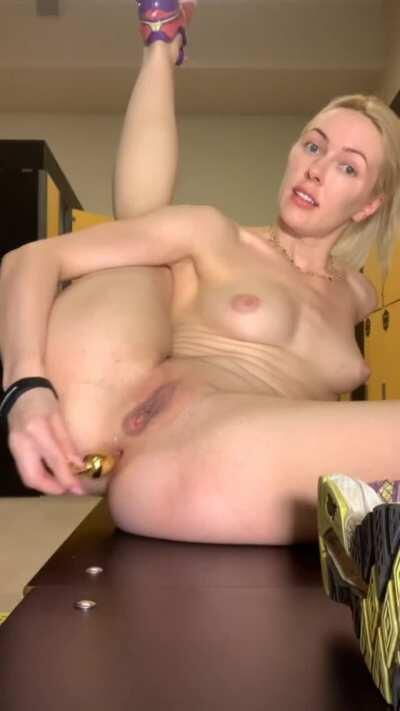 I love to play with butt plug in locker room before training