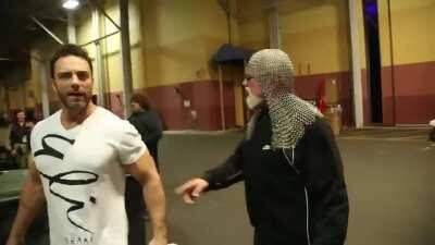 Scott Steiner attacks a random fat guy backstage
