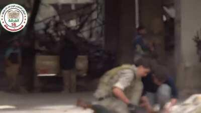FSA fighters use a classic Toyota Technical, LMGs, and AKs to engage an occupied high rise - Aleppo - 1/27/2015