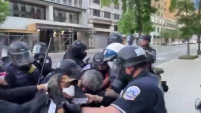Protesters hand rioter over to police