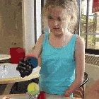 8-year-old trying out her bionic arm for the first time