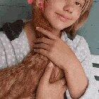 Happy pet chicken being cuddled