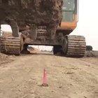 Skilled excavator driver attempting the lighter trick