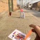 Slingshot card snipes balloon