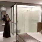 Bathroom glass that turns opaque when the door closes