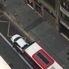Man parks on the bus lane and dares the bus driver to run over it