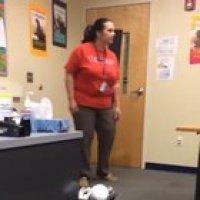 Student hides under desk and grabs teacher's ankle