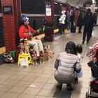 He sings pretty woman with his dolls. 53rd &3rd ave street M/E train station