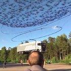 Drones lifting a truck
