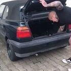 Placing a firecracker in your trunk.