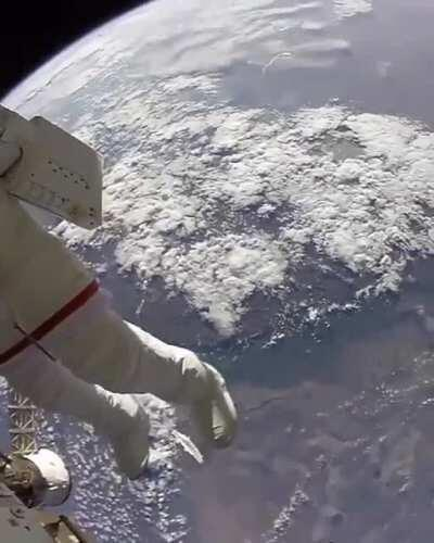 Astronauts on a space walk.