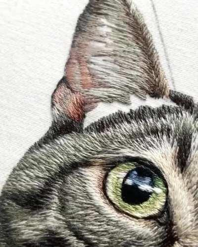 This tabby cat embroidery took 50+ hours and thousands of tiny stitches