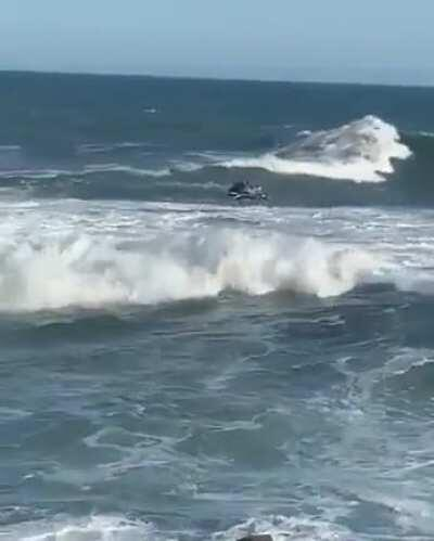 WCGW Trying to jump a wave on a jet ski