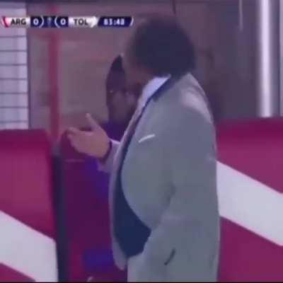 A soccer / football coach