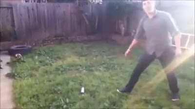 Throwing a knife into a spray can.
