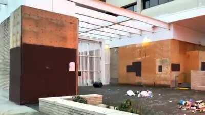 [Alternate Angle] Anarcho-Democrats/Antifa attack Federal immigration jail in broad daylight by rolling flaming dumpster near plywood-covered building