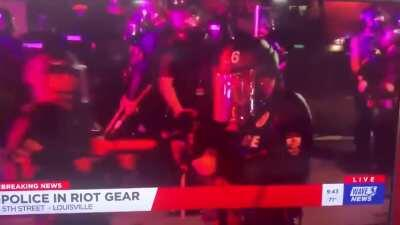 Louisville, Kentucky cops lighting up a news crew with rubber bullets