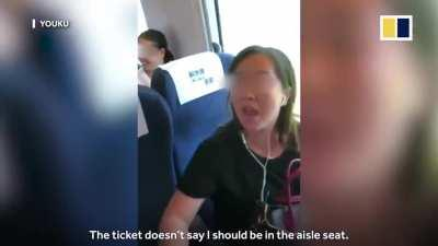 Entitled Karen refuses to leave seat that was not assigned to her