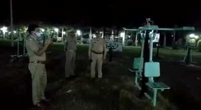 Video shows police officers investigating a piece of playground equipment that is moving on its own