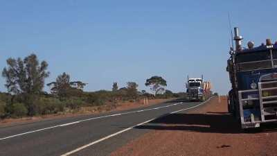 Hauling gold ore from mine to treatment plant in Australia, 86 wheels, 4 trailers, 175 tons!