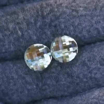 A pair of round pixel cuts in prasiolite that I cut for a pair of earrings