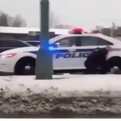 A gentle cop using his newly learned techniques to apprehend someone