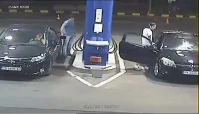 Gas station worker puts out the cigarette as a precaution