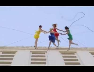 Dancing on top of a building