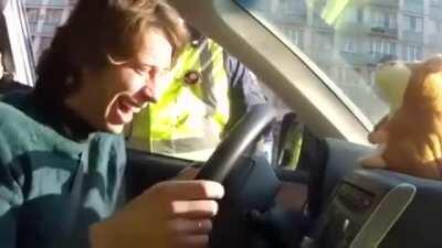 Man with toy that repeats words gets pulled over and can't keep it together