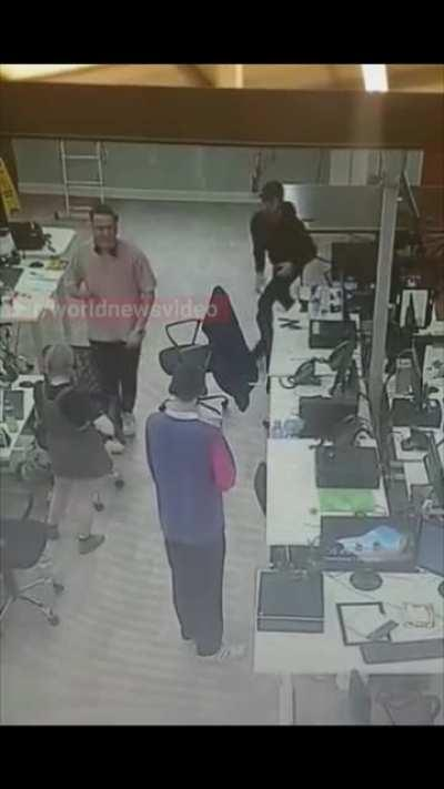 Man recognizes a woman having a seizure and catches her before she hits the ground
