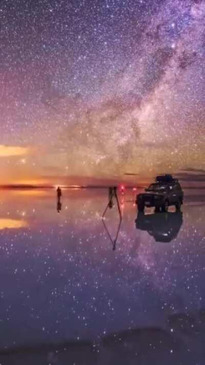 Night sky reflection on world's largest natural mirror timelapse