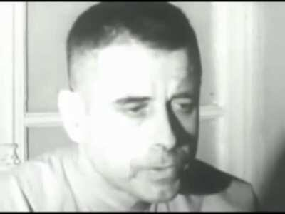 Commander Jeremiah Denton giving a forced interview from the Hanoi Hilton, in 1966, during which he pretends the lighting bothers his eyes. He is actually blinking Morse code for