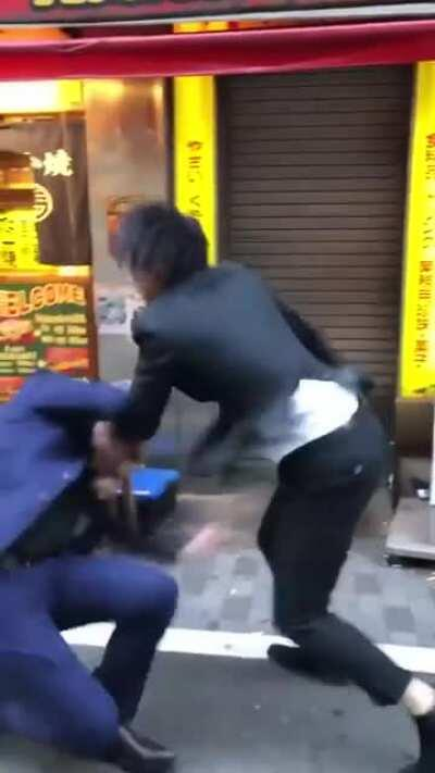 Japanese guy gets hit over the head with a stool