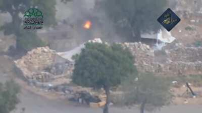 Ahrar al-Sham fighters hit a BMP with a Metis causing it catch fire. Latakia. June 10th, 2015.