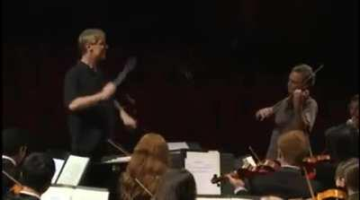 Orchestra plays Happy Birthday for the conductor.