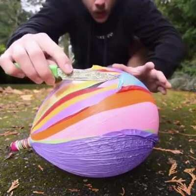 Shaky-handed man pops many balloons