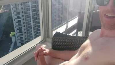 Stroking on the balcony