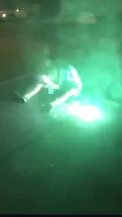 This young man having a seizure and trying to let people shooting fireworks at him know