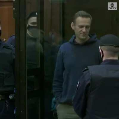 Alexey Navalny makes a heart gesture as his wife and supporters look on while a Russian court orders the opposition leader to more than two years in a prison camp.