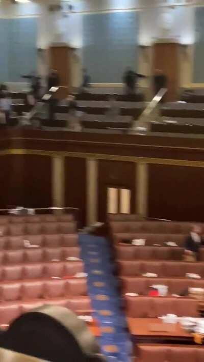 Video from inside the US Capitol chamber, police in an armed standoff with protestors outside the door