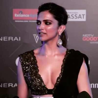 Who else can't control their left hand to slip inside right strap of her(Deepika Padukone) dress, feel her right boob bump on your palm; while her nipple bending to your palm as you gently grope her right tit ! Watch her left boob sudden tightness at 00:1