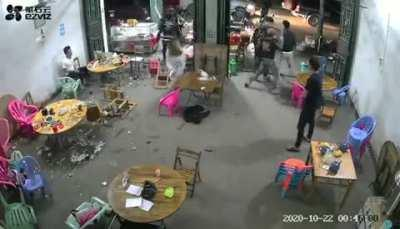 Gang attack on a Chinese restaurant - attackers are carrying Guandao (pole with blade).