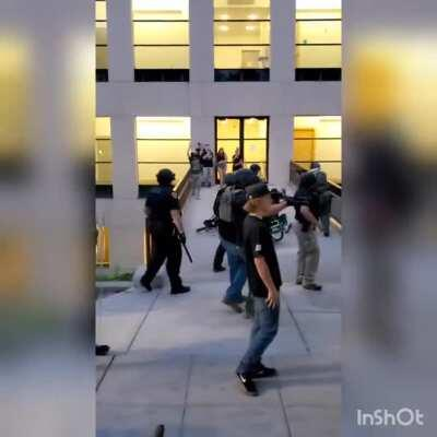 Downtown Salt Lake City May 30th 2020. Unarmed civilian face down prone on the ground GETS SHOT IN THE SPINE AT POINT BLANK WITH BEAN BAG GUN. Where is this in your training manual?