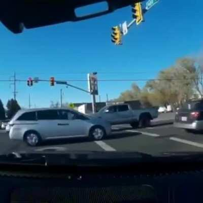 Speeding through a red light and causing a pile up