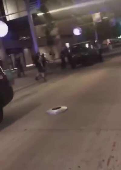 Protester follows police instructions to surrender their shield