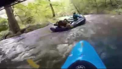 Two women fighting while river rafting