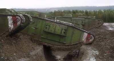 "Restored WWI footage of British Mark IV tanks crossing a trench, 1917. From Peter Jackson's ""They Shall Not Grow Old."""